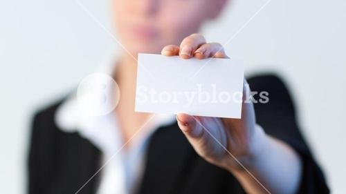 Business woman holding out a business card
