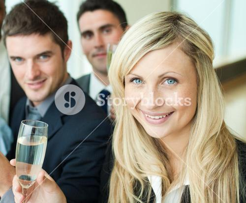 Businesspeople celebrating a success with champagne