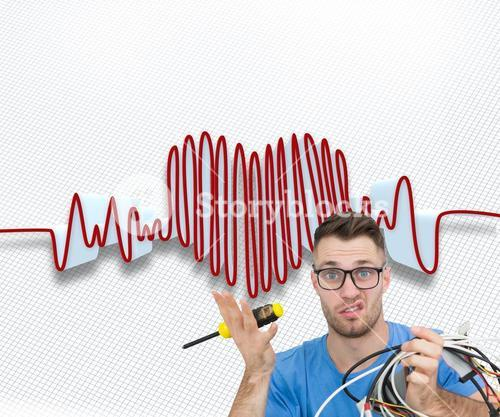 Composite image of portrait of confused it professional with screw driver and cables in front of ope