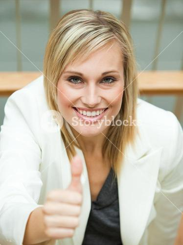 Businesswoman smiling with her thumb up