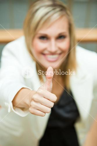 Businesswoman smiling with her thumbs up
