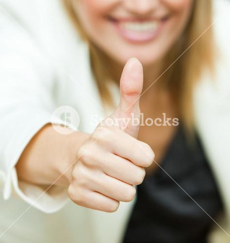 Businesswoman with her thumbs up