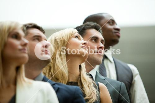 Businesspeople looking up