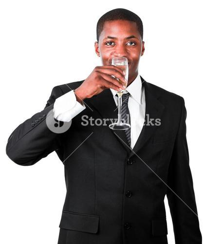 Friendly businessman drinking a glass of champagne