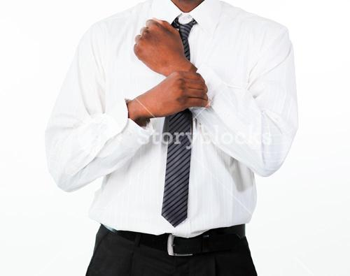 Close up of businessman correcting a cuff link