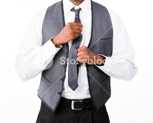 Close up of a business man correcting his tie
