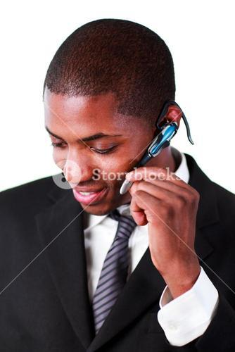 Businessman using an bluetooth earpiece