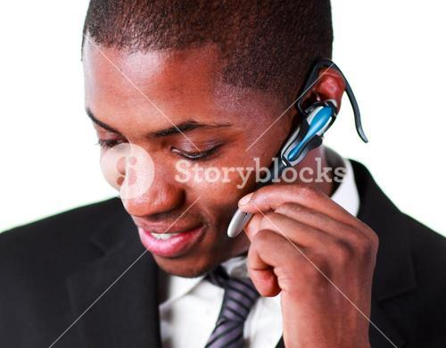 Close up of an businessman using an bluetooth earpiece