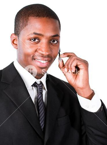 Businessman wearing an earpiece in front of the camera