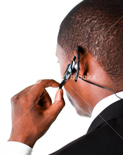 Close up of an Businessman showing his earpiece