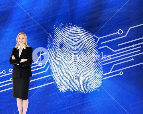 Composite image of a confident businesswoman with folded arms