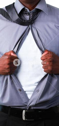 Close up of a businessman showing tshirt under his suit