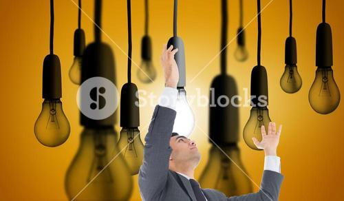 Composite image of unsmiling businessman with arms raised