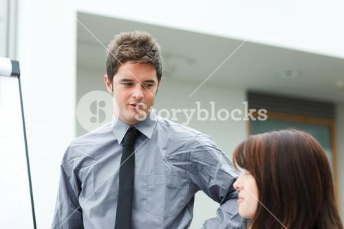Young businessman speaking in a presentation