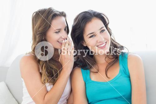Female friends gossiping in the living room
