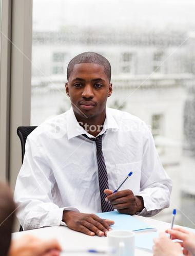 Businessman writing in an office