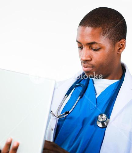 Young doctor working on a laptop