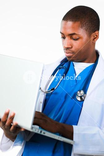 Portrait of an young doctor working on a laptop