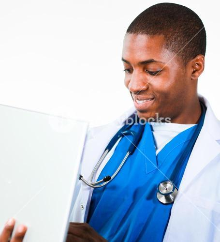 Close up of an friendly doctor working on a laptop