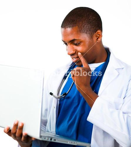 Close up of an Thoughtful doctor working with a computer