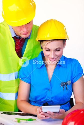 Female and male with hard hat working