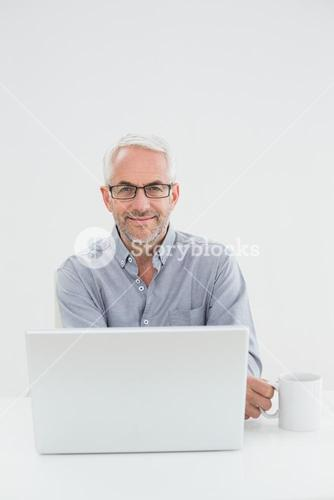 Businessman with laptop and coffee cup