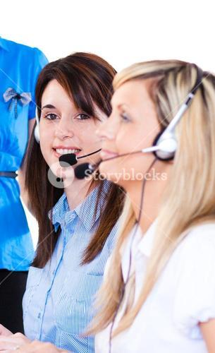 Brunette girl working with a headset on