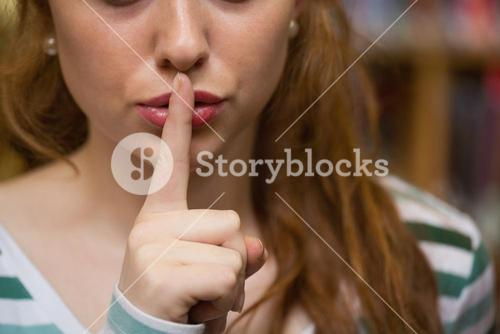 Redhead student asking for silence