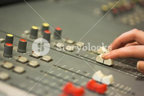 Student working on sound mixer adjusting levels