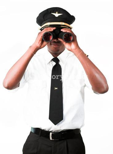 Handsome pilot looking through Binoculars