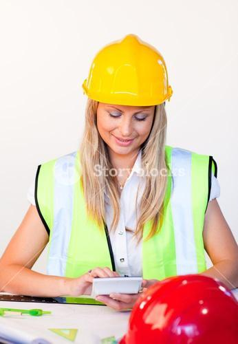 Blonde woman working with hard hat on