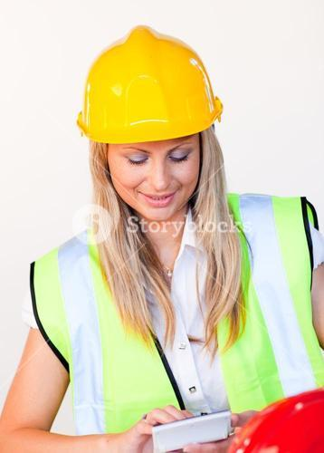 Worker with hard hat looking at drawing