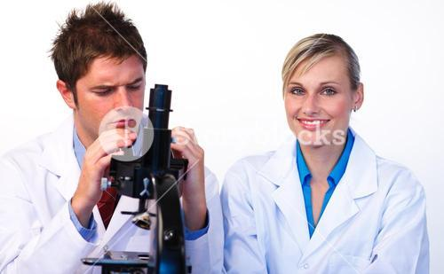 Science students looking through a microscope