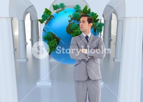 Composite image of serious businessman with arms crossed