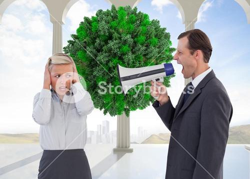 Composite image of businessman shouting at colleague with his bullhorn