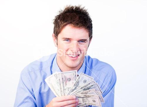 Young businessman showing dollars
