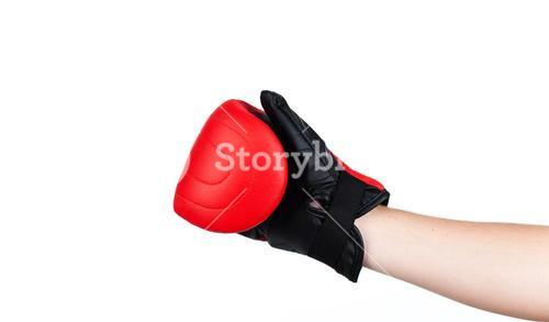isolated shot of a man wearing boxing gloves