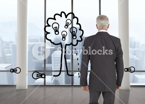 Composite image of businessman walking away from camera
