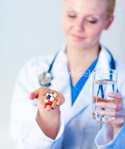 Doctor holding pills to camera