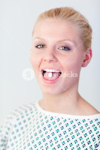 Patient with a pill in her mouth