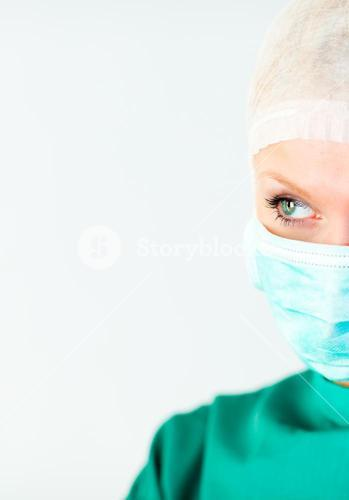 Bright female surgeon with a mask