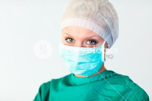 Attractive female surgeon with a mask
