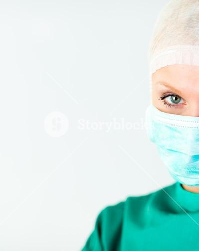 Attractive female doctor with a mask