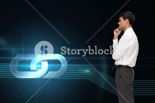 Composite image of thoughtful young businessman looking away