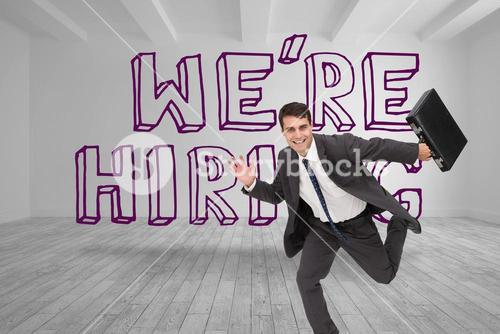 Businessman running in front of were hiring graphic