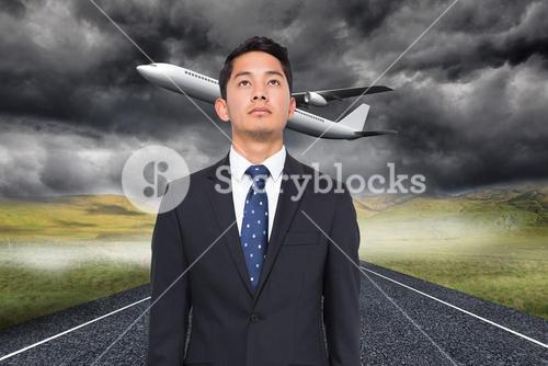 Composite image of 3d plane taking off over street