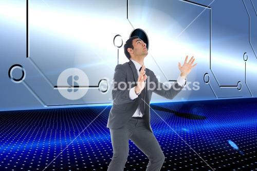 Composite image of unsmiling businessman catching
