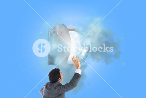 Composite image of businessman with arms raised