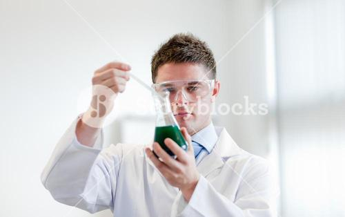 Handsome doctor making an experience