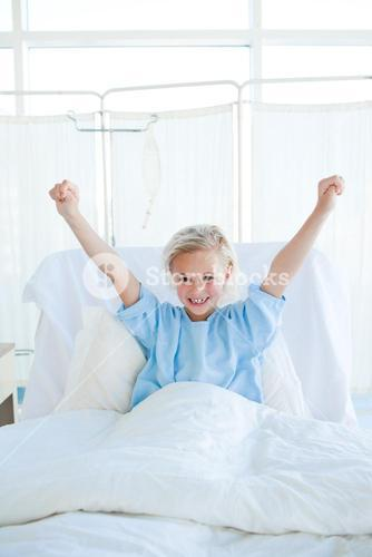 Happy child patient punching the air